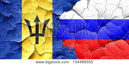 Barbados flag with Russia flag on a grunge cracked wall