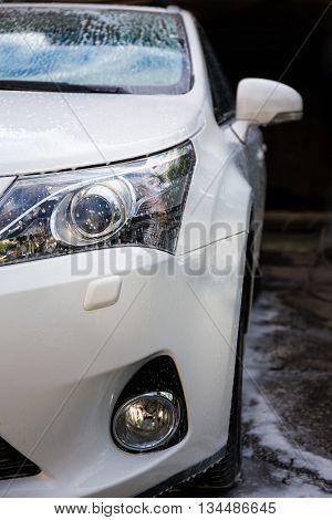 Car Wash Concept - Clean Car In Foam