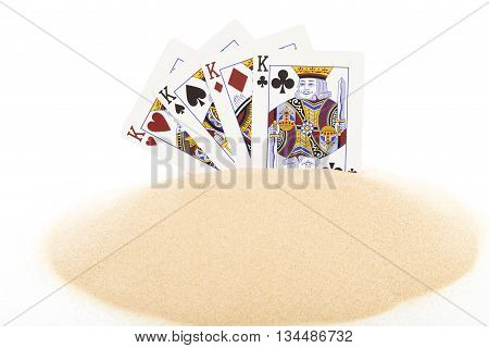 Playing cards on heap of sand as a concept. Isolated on a white background.