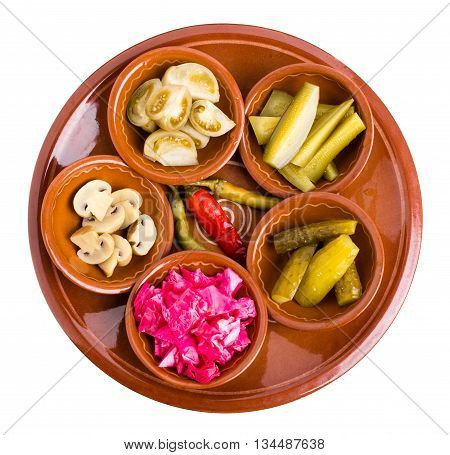 Platter of mixed marinated vegetables. Isolated on a white background.