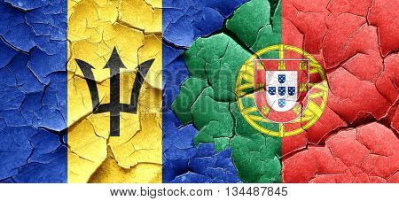 Barbados flag with Portugal flag on a grunge cracked wall