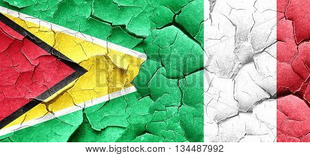 Guyana flag with Italy flag on a grunge cracked wall