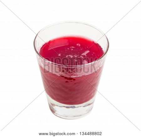 Glass with sweet cherry jelly. Isolated on a white background.
