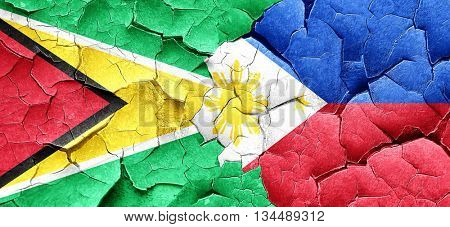 Guyana flag with Philippines flag on a grunge cracked wall