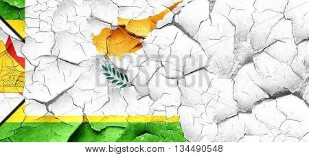 Zimbabwe flag with Cyprus flag on a grunge cracked wall
