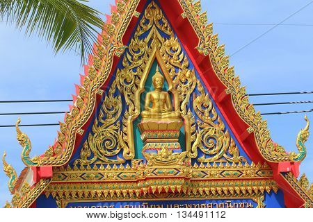 top of entry gate to Buddhist temple in southern Thailand, near Ranot, Songkhla Province