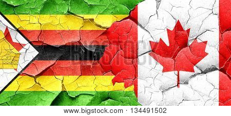 Zimbabwe flag with Canada flag on a grunge cracked wall