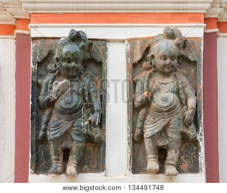 Chettinad India - October 17 2013: Chidambara Palace in Kadiapatti. Two of a series of identical Krishna statues on plinth traversing the entire front facade.