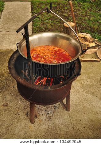 Traditional Goulash soup is boiling in the garden