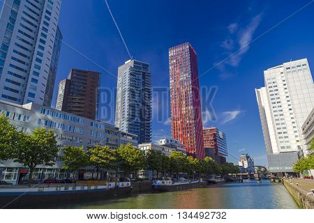 Rotterdam, Netherlands - 24 MAY 2015: Modern residential towers in Rotterdam during clear sunny day. Central tower is named 'the red apple' designed by KCAP architects and Jan des Bouvrie