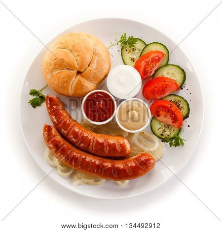 Fried sausages and vegetables