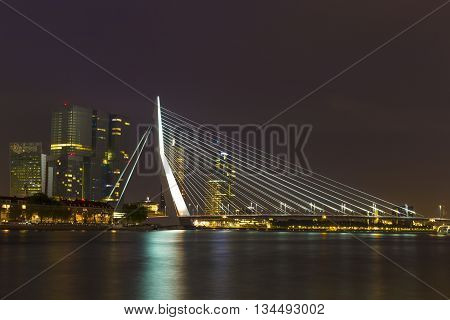 Rotterdam, Netherlands - 24 MAY 2015: Nightview of the Erasmus Bridge reflected in Nieuwe Maas river in Rotterdam Netherlands