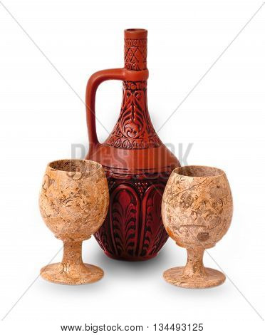 clay jug with wine and glasses on the white