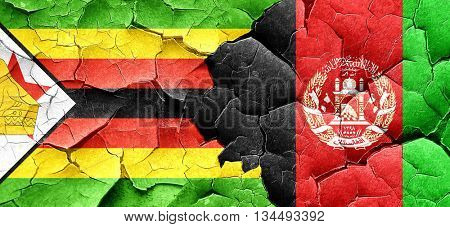 Zimbabwe flag with afghanistan flag on a grunge cracked wall