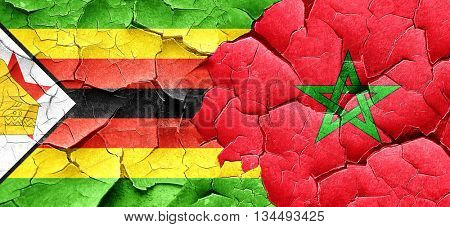Zimbabwe flag with Morocco flag on a grunge cracked wall
