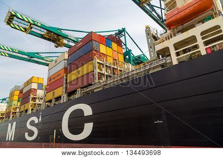 Antwerp, Belgum - 1 August 2015: Close-up of large cargo container vessel from the Mediterranean Shipping Company (MSC) in the port of Antwerp Belgium.