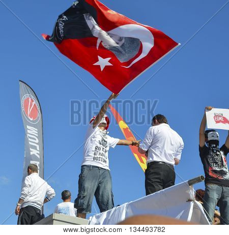 Istanbul Turkey - June 9 2013: A view from the protests in Taksim Square. It has started action against the construction of a shopping center instead of cutting trees in Gezi Park in Istanbul. A large portion of Turkey It spreads. A wave of demonstrations