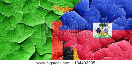 Zambia flag with Haiti flag on a grunge cracked wall