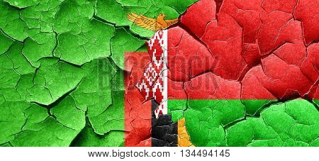 Zambia flag with Belarus flag on a grunge cracked wall
