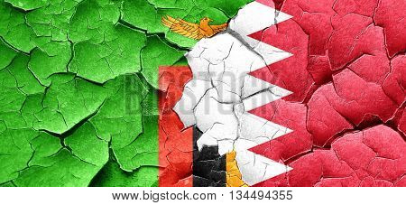 Zambia flag with Bahrain flag on a grunge cracked wall