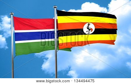 Gambia flag with Uganda flag, 3D rendering