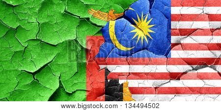 Zambia flag with Malaysia flag on a grunge cracked wall