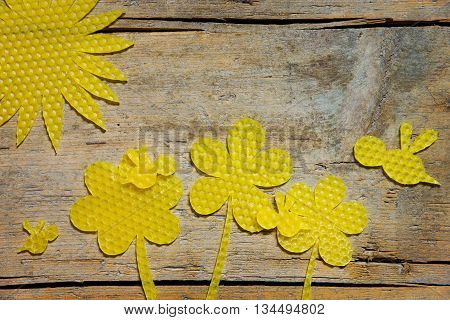 Beeswax, Flowers, Bees And The Sun On Wooden Table