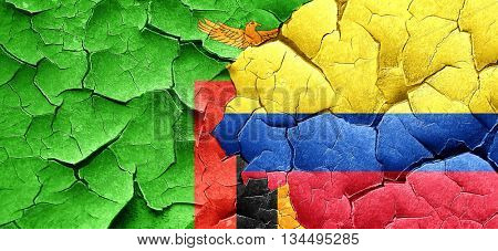 Zambia flag with Colombia flag on a grunge cracked wall
