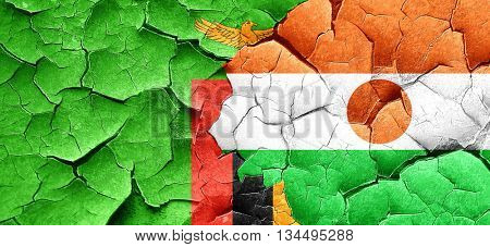 Zambia flag with Niger flag on a grunge cracked wall
