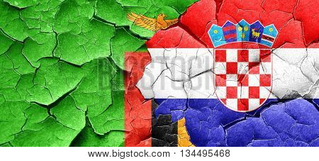 Zambia flag with Croatia flag on a grunge cracked wall