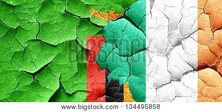 Zambia flag with Ireland flag on a grunge cracked wall