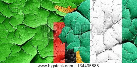 Zambia flag with Nigeria flag on a grunge cracked wall