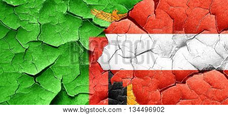 Zambia flag with Austria flag on a grunge cracked wall