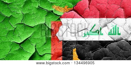 Zambia flag with Iraq flag on a grunge cracked wall