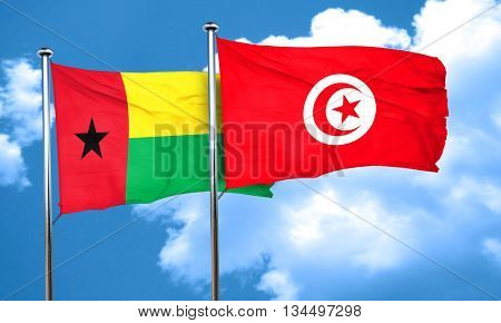 Guinea bissau flag with Tunisia flag, 3D rendering