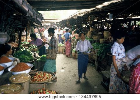 PAGAN / MYANMAR - CIRCA 1987: People shop for fresh produce at the bustling Nyaung U market in Pagan.