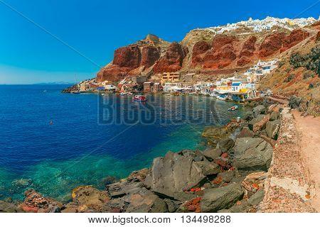 Fishing boats at Old port Ammoudi of Oia village at Santorini island in Aegean sea, Greece