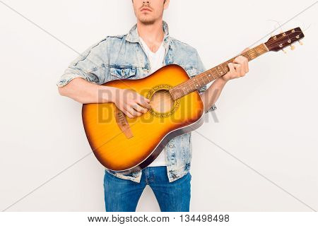 Close Up Portrait Of  Serious Cool Man Playing On The Guitar