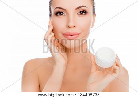 Sensitive Pretty  Smiling Woman Using Cream For Face