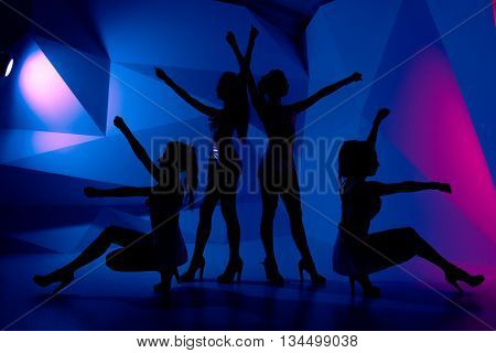 Photo Of Silhouettes Of Four Sexy Posturing Girls In Dark