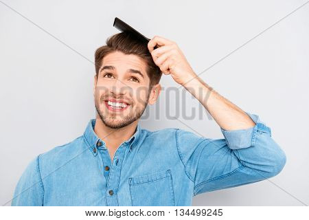 Handsome Smiling Young Man Doing Modern Hairstyle