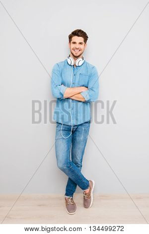 Full Photo Of Happy Young Man Crossing Hands With  Headphones
