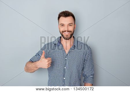 Happy Young Businessman Showing Thumb Up On Gray Background