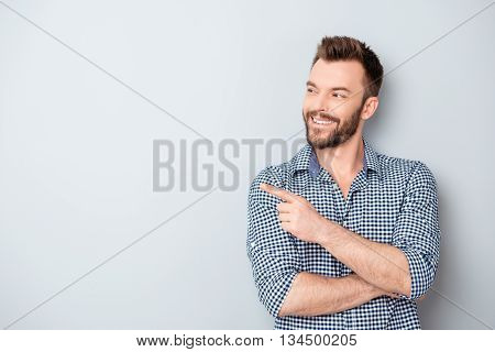 Cheerful Handsome Man Showing Direction And Pointing With Finger