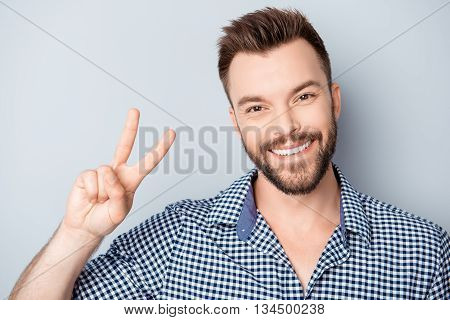 Handsome Man With Beaming Smile Showing Two Fingers