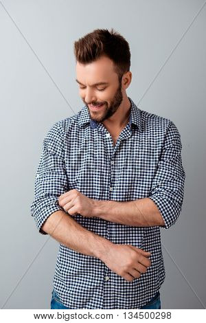 Handsome Businessman Rolling Up His Shirt Sleeves