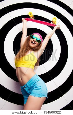 Hipster Cool Woman In Glasses Holding Skate And Smiling