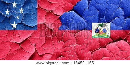 Samoa flag with Haiti flag on a grunge cracked wall