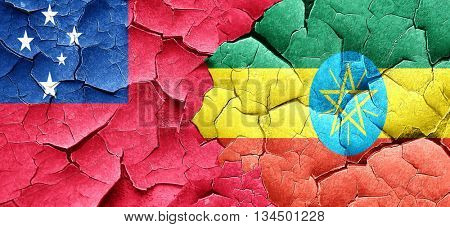 Samoa flag with Ethiopia flag on a grunge cracked wall
