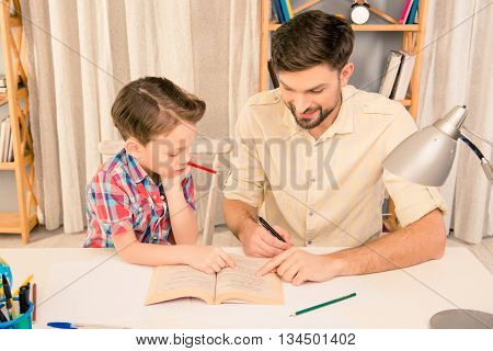 Young Careful Father Teaching His Little Son